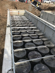 BayFilter vault with hold downs