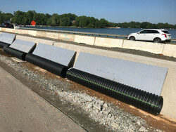 Duraslot Leaning on Highway Wall